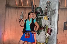 Runner poses with Boba Fett during Star Wars Rival Run Weekend.