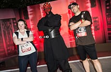 Runners pose with Darth Maul before the Star Wars 10K during Star Wars Half Marathon – The Dark Side race weekend.