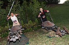 3.	Runners pose on Star Wars speeder bikes at the Star Wars 10K during Star Wars Half Marathon – The Dark Side race weekend.