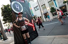 Runner poses at mile 4 of the Star Wars 10K for the Star Wars Dark Side Challenge during Star Wars Half Marathon – The Dark Side race weekend.