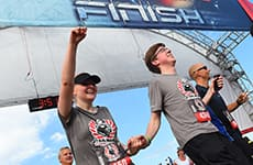 2.	Runners cross the finish line of the Star Wars Half Marathon – The Dark Side for the Star Wars Dark Side Challenge.