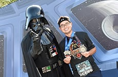 Runner celebrates after Star Wars Half Marathon – The Dark Side with Darth Vader.