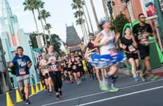 Runners run through Disney's Hollywood Studios during the Star Wars Half Marathon – The Dark Side.
