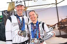 3.Runners dressed as Stormtroopers celebrate with their medals after Star Wars Half Marathon – The Dark Side.