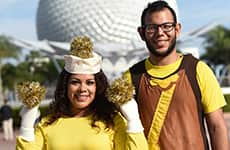 Runners dressed as Lumiere and Cogsworth for Lumiere's Two Course Challenge in Epcot