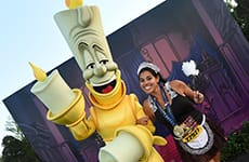 Runner celebrating with Lumiere after the Disney Wine & Dine 10K