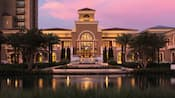 The entrance to the Four Seasons Orlando Resort has a pond and neoclassical architecture