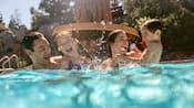 A family splashes in a pool