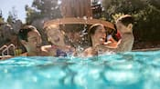 A family of enjoy the outdoor pool at Disney's Grand Californian Hotel and Spa