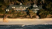 Disney's Beach House, with wooden walkway and stairs to the beach