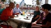 Four adults turn a business meeting into a special occasion at a Disneyland Resort restaurant