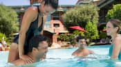 A family enjoys the pool at Disney's Grand Californian Resort