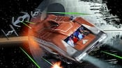 A Starspeeder 1000 vehicle travels past the collapsing Death Star