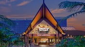 The entrance of Tangaroa Terrace, lit up against a dusky sky