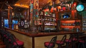 Inside Trader Sam's Enchanted Tiki Bar with tiki carvings and plenty of treasures and trinkets