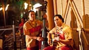 Two musicians play guitar and stand-up bass on the patio at Trader Sam's Enchanted Tiki Bar
