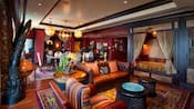 Adventureland Suite, decorated with oriental rugs, dark wood furniture and rich tapestries