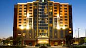 The front of the 14 story Embassy Suites Anaheim South lit up at night
