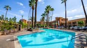 The large pool area has ample deck space, lounge chairs and palm trees