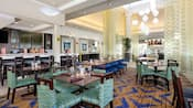 Modern dining tables are ready for guests at the Hilton Garden Inn's restaurant and lounge area