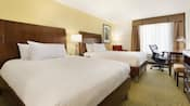 A standard room at the Hilton Garden Inn features double queen size beds, chairs, a desk and dresser