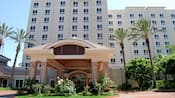 Rose bushes and palm trees accent the area around the entrance to the Holiday Inn Anaheim Resort Area