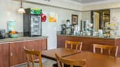 The Anaheim Quality Inn Suites breakfast bar area includes the counter and dining tables for Guests