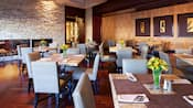 Evoking a sophisticated feel, the restaurant is decorated with modern dining tables, chairs and art