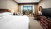 Decorated with contemporary furnishings, this room includes a king-size bed and a balcony with a great view