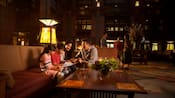 A family of four sits in the lobby of Disney's Grand California Hotel & Spa