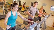 Guests work out on treadmills at the fitness center at Disney's Grand Californian Hotel & Spa
