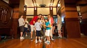A family of four participates in The Grand Quest scavenger hunt through the hotel