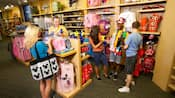 Guests browse through the colorful merchandise of a well-stocked gift shop