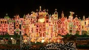 "Thousands of holiday lights illuminate the exterior of ""it's a small world� at Disneyland"