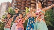 A family learns Hawaiian dancing