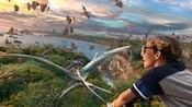 Un garçon vole dans le ciel avec des Na'vi et des banshee des montagnes au-dessus de Pandora