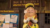 """Russell from Disney•Pixar's """"Up"""" awaits Guests at a Character Greeting experience on Discovery Island"""