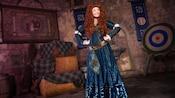 Merida stands in a castle-like room at Meet Merida Fairytale Garden in Fantasyland