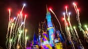 Fireworks blast off above Magic Kingdom park as vibrant lighting effects illuminate Cinderella Castle