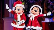 Mickey dressed as Santa Claus and Minnie dressed as Mrs Claus