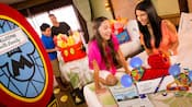 A young family is thrilled to find Disney gifts and surprises waiting for them in their hotel room
