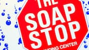 Stop sign-design laundry sign that states 'The Soap Stop, Vending Center'