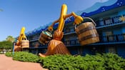 2 giant versions of the bucket-wielding dancing mops from Disney's Fantasia adorn the side of Disney's All-Star Movies Resort