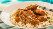 Chicken tikka masala on a bed of rice in a bowl