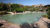 Samawati Springs Pool at Disney's Animal Kingdom Lodge featuring zero-depth entry and a long slide