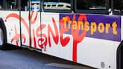 Side of a bus with lettering that says 'Disney Transport'