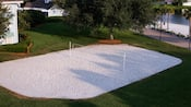 Overhead view of a white-sand volleyball court