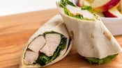 A chicken wrap stuffed with lettuce and chicken breast