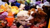 Close-up of an assortment of plush toy prizes in a Disney hotel arcade