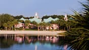 View from the lake of a sandy beach at Disney's Caribbean Beach Resort